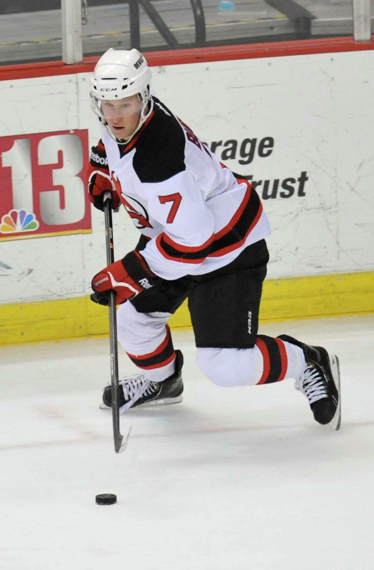 Albany Devils' Brandon Burlon (7) moves the puck against the Binghamton Senators' during the second period of an AHL hockey game in Albany, N.Y., Sunday, March 30, 2014. (Hans Pennink / Special to the Times Union) ORG XMIT: HP112