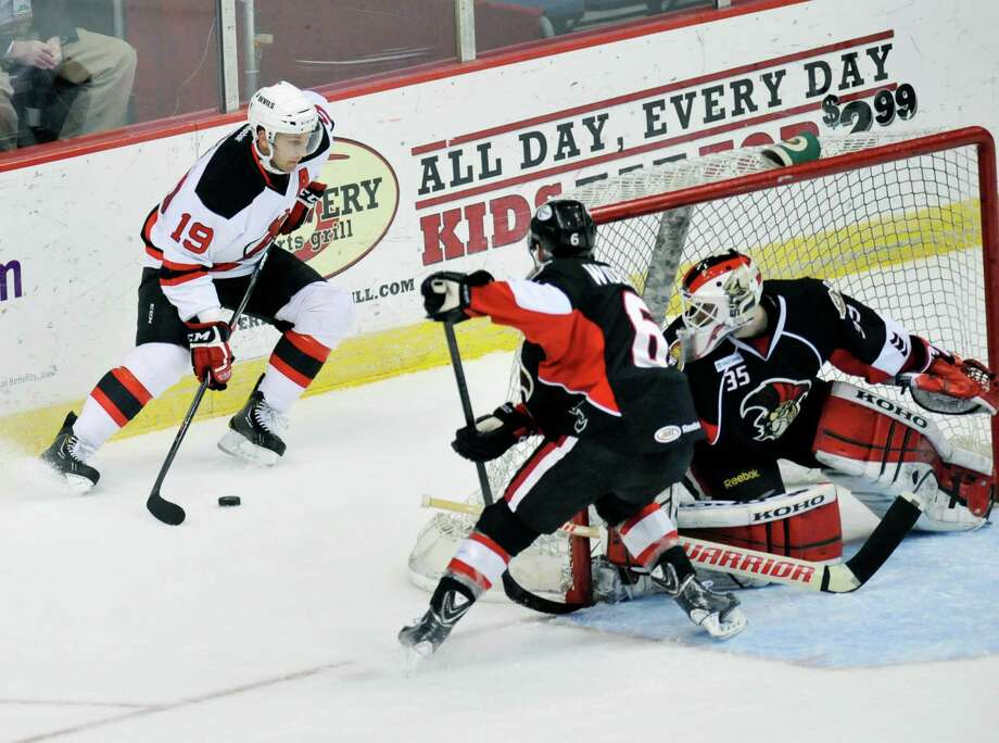 Albany Devils' Mike Sislo (19) moves the puck against the Binghamton Senators' during the first second of an AHL hockey game in Albany, N.Y., Sunday, March 30, 2014. (Hans Pennink / Special to the Times Union) ORG XMIT: HP111 Photo: Hans Pennink / 00026292A