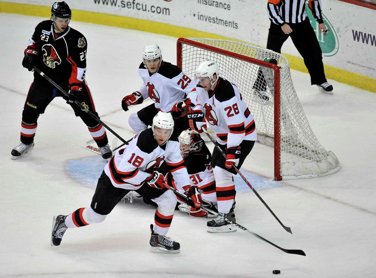 Albany Devils' Stefan Matteau (18) clears the puck from the goal against the Binghamton Senators' during the first period of an AHL hockey game in Albany, N.Y., Sunday, March 30, 2014. (Hans Pennink / Special to the Times Union) ORG XMIT: HP110