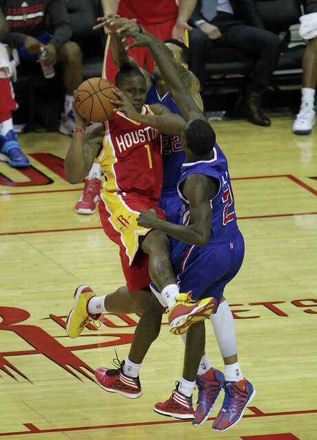 Isaiah Canaan, left, runs into trouble against the Clippers' Matt Barnes, center, and Darren Collison during the 20-minute stint Saturday night in which the Rockets rookie guard scored 14 points. Photo: James Nielsen, Staff / © 2014  Houston Chronicle