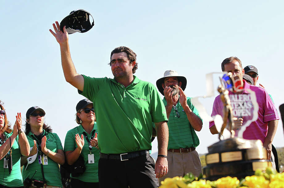Steven Bowditch waves at the crowd after winning the 2014 Valero Texas Open at TPC San Antonio, Sunday, March 30, 2014. Bowditch, of Brisbane, Australia, shot an 8-under par to finish in the top stop. Coming in tied for second were Will MacKenzie, of Jupiter, Florida, and Daniel Summerhays, of Farmington, Utah. They shot a 7-under game. Photo: Jerry Lara, San Antonio Express-News / ©2014 San Antonio Express-News