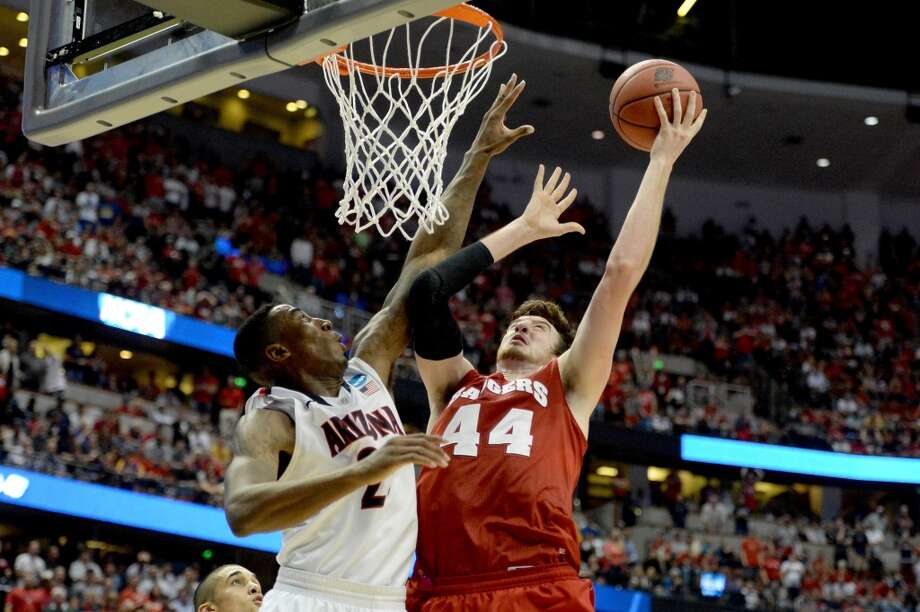 March 29: Elite 8 No. 2 Wisconsin 64, No. 1 Arizona 63 (OT) Frank Kaminsky #44 of Wisconsin goes up for a shot over Rondae Hollis-Jefferson #23 of Arizona. Photo: Harry How, Getty Images