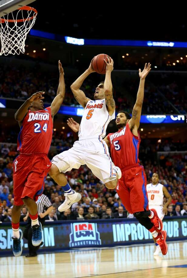March 29: Elite 8 No. 1 Florida 62, No. 11 Dayton 52 Scottie Wilbekin #5 of Florida goes to the basket as Jordan Sibert #24 and Devin Oliver #5 of Dayton defend. Photo: Streeter Lecka, Getty Images