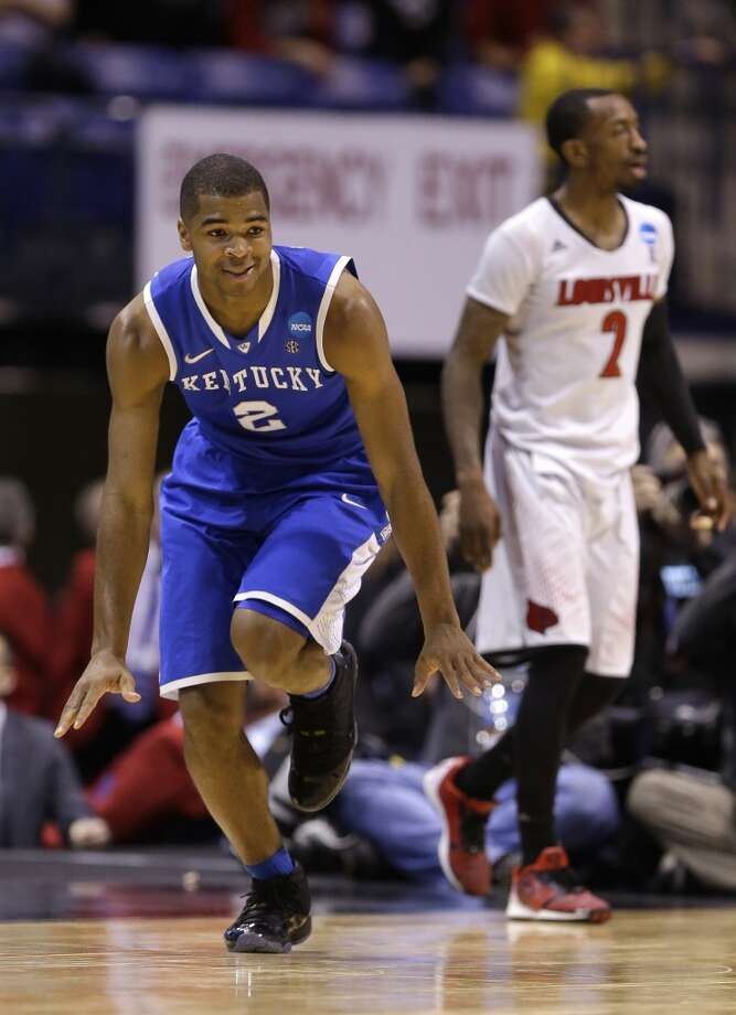 March 28: Sweet 16 No. 8 Kentucky 74, No. 4 Louisville 69 Kentucky's Aaron Harrison celebrates after making a three-point basket in front of Louisville's Russ Smith. Photo: Michael Conroy, Associated Press