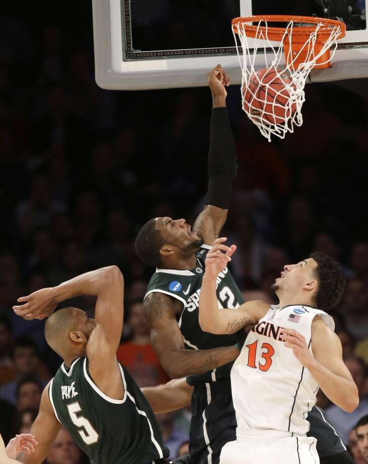 March 28: Sweet 16 No. 4 Michigan State 61, No. 1 Virginia 59 Michigan State's Branden Dawson, center, scores past Virginia's Anthony Gill. Photo: Seth Wenig, Associated Press