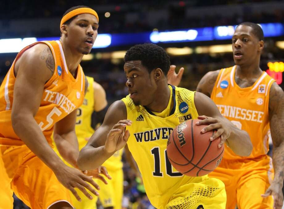 March 28: Sweet 16  No. 2 Michigan 73, No. 11 Tennessee 71 Michigan's Derrick Walton Jr. drives against Tennessee defender Jarnell Stokes. Photo: Kirthmon F. Dozier, McClatchy-Tribune News Service