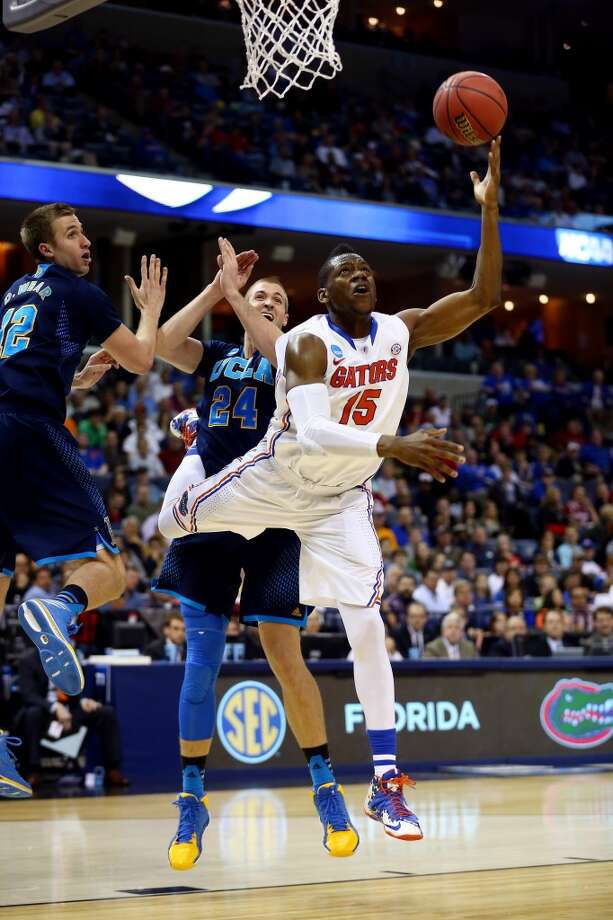 March 27: Sweet 16  No. 1 Arizona 70, No. 4 SDSU 64 Will Yeguete of the Gators goes to the basket as Travis Wear of UCLA defends. Photo: Streeter Lecka, Getty Images