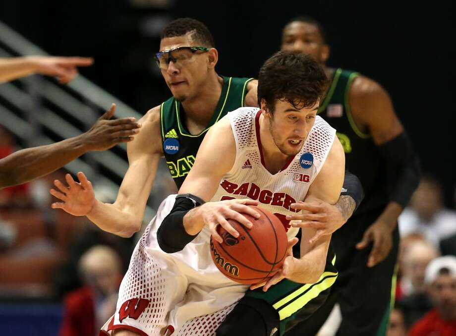 Frank Kaminsky of Wisconsin is fouled in the second half by Isaiah Austin of Baylor. Photo: Jeff Gross, Getty Images