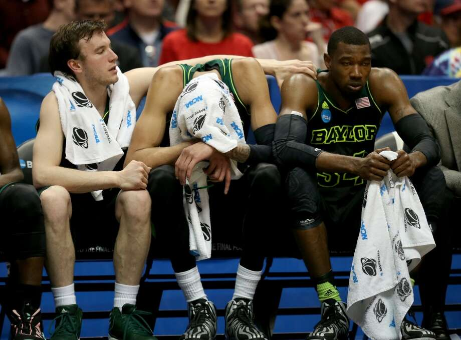 Brady Heslip, Isaiah Austin and Cory Jefferson of Baylor sit on the bench. Photo: Jeff Gross, Getty Images
