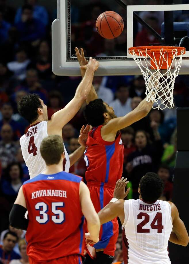 March 27: Sweet 16  No. 11 Dayton 82, No. 10 Stanford 72 Devin Oliver of Dayton goes to the basket as Stefan Nastic of Stanford defends. Photo: Kevin C. Cox, Getty Images