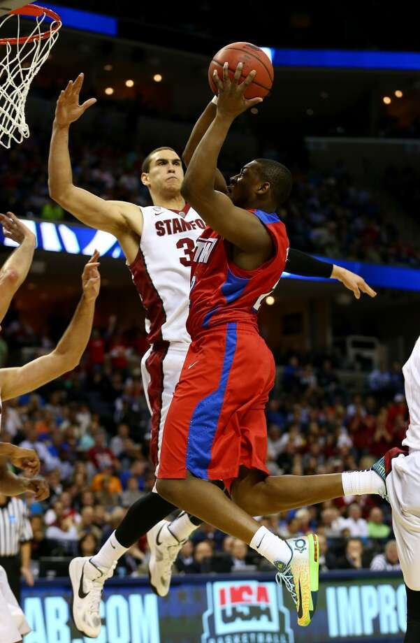 Kendall Pollard of Dayton goes to the basket as Dwight Powell of Stanford defends. Photo: Streeter Lecka, Getty Images