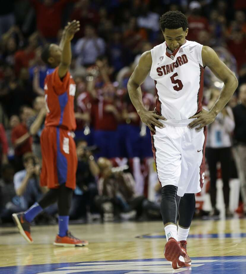 Stanford guard Chasson Randle (5) walks off the court. Photo: Mark Humphrey, Associated Press