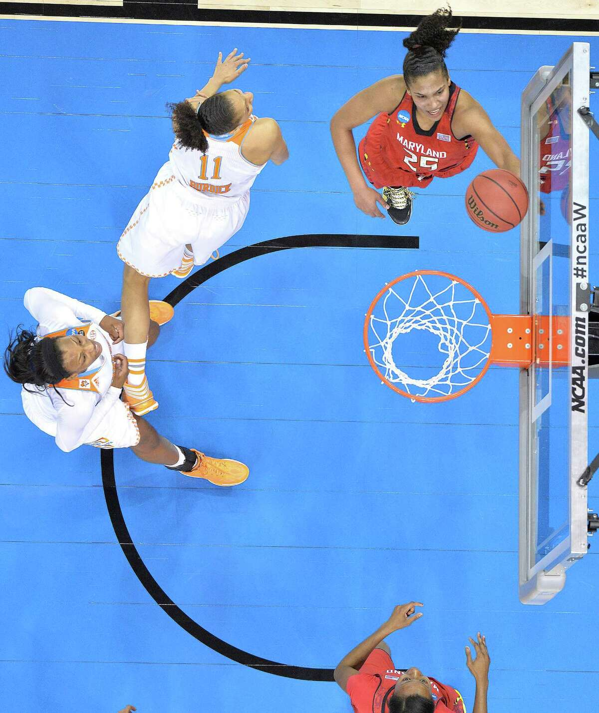 Maryland's Alyssa Thomas, top right, shoots past the defense of Tennessee's Cierra Burdick during the second half in a regional semifinal game at the NCAA women's college basketball tournament on Sunday, March 30, 2014, in Louisville, Ky. Maryland defeated Tennessee 73-62. (AP Photo/Timothy D. Easley) ORG XMIT: KYTE105