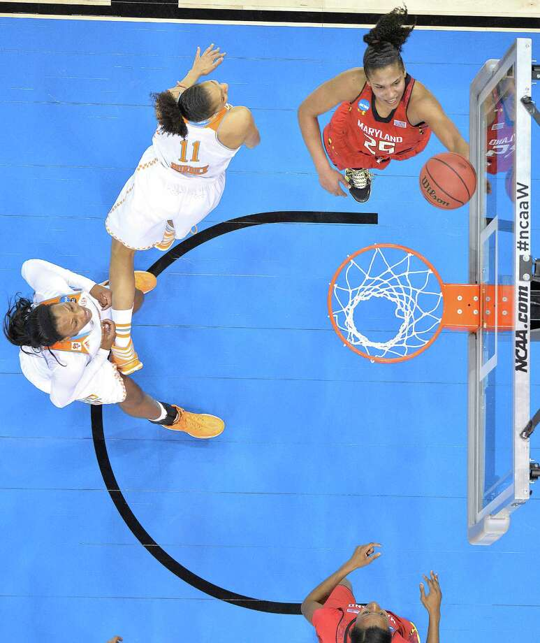 Maryland's Alyssa Thomas, top right, shoots past the defense of Tennessee's Cierra Burdick during the second half in a regional semifinal game at the NCAA women's college basketball tournament on Sunday, March 30, 2014, in Louisville, Ky. Maryland defeated Tennessee 73-62. (AP Photo/Timothy D. Easley) ORG XMIT: KYTE105 Photo: Timothy D. Easley / AP