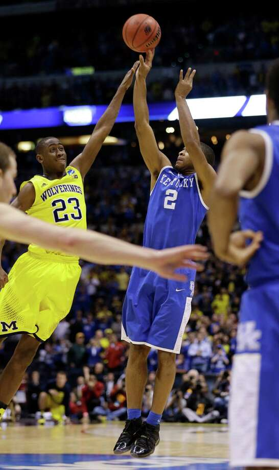 Kentucky's Aaron Harrison (2) shoots a three-point basket past Michigan's Caris LeVert (23) in the final second of the second half of an NCAA Midwest Regional final college basketball tournament game Sunday, March 30, 2014, in Indianapolis. Kentucky won 75-72. (AP Photo/David J. Phillip)  ORG XMIT: INKS164 Photo: David J. Phillip / AP