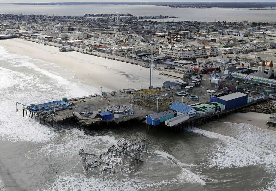 FILE - This Oct. 31, 2012 file photo, shows an aerial view of the damage to an amusement park left in the wake of Superstorm Sandy, in Seaside Heights, N.J.  Freaky storms like 2013's Typhoon Haiyan, 2012's Superstorm Sandy and 2008's ultra-deadly Cyclone Nargis may not have been caused by warming, but their fatal storm surges were augmented by climate change's ever rising seas, Maarten van Aalst, a top official at the International Federation of Red Cross and Red Crescent Societies said. Global warming is driving humanity toward a whole new level of many risks, a United Nations scientific panel reports, warning that the wild climate ride has only just begun.  (AP Photo/Mike Groll, File) Photo: Mike Groll, Associated Press