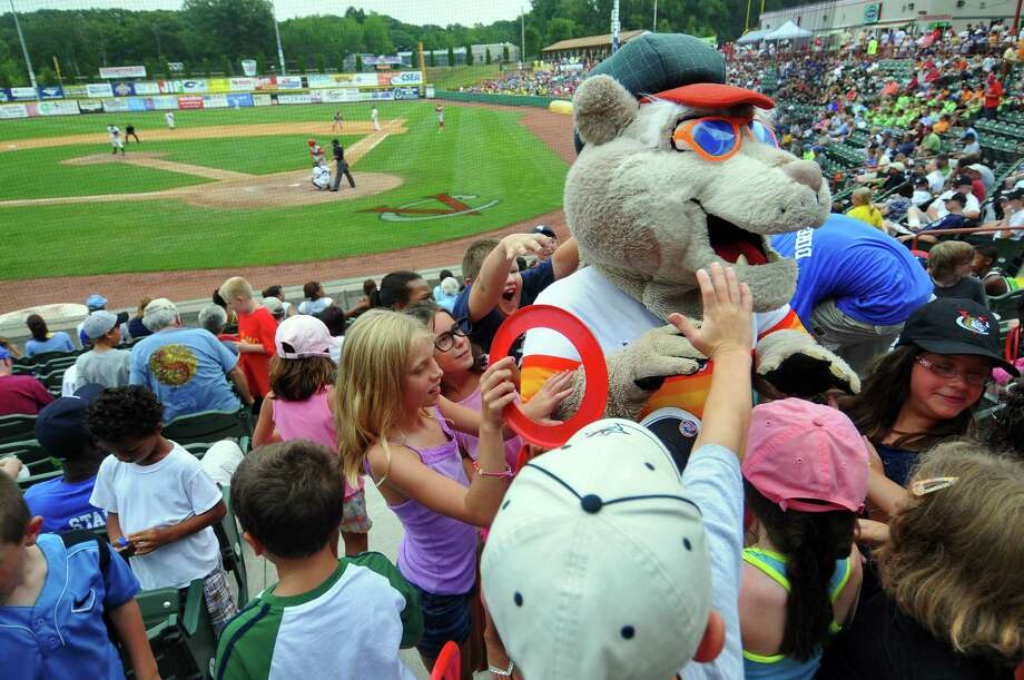 Children surround a mascot for autographs during the Tri-City Valley Cats game against the Williamsport Crosscutters, during Camp Day at Joseph Bruno Stadium in Troy, NY on Thursday August 12, 2010.  Walt Myers of Selkirk was inside the mask.  ( Philip Kamrass / Times Union ) Photo: Philip Kamrass / 00009270V