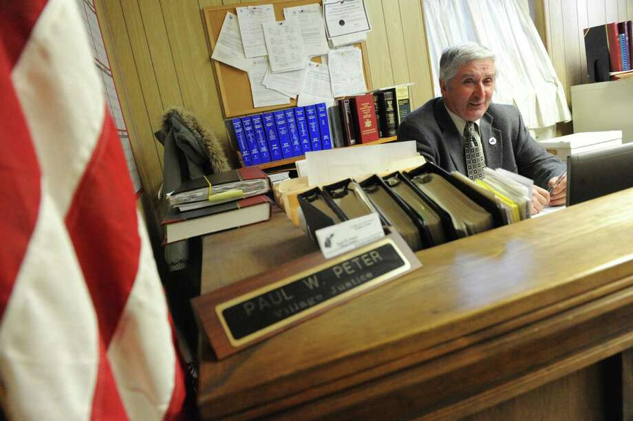 Village Justice of sixteen-years Paul W. Peter presides over the final day of Castleton Court on Tuesday March 25, 2014 in Castleton, N.Y. (Michael P. Farrell/Times Union) Photo: Michael P. Farrell / 00026260A