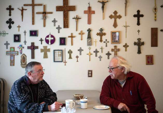 Ron Wolff and Gordy Beil of Darrington enjoy coffee after services at the Episcopalian Church of the Transfiguration on Sunday, March 30, 2014. A significant number of the church members live on the opposite side of the Oso mudslide and were unable to attend Sunday services. Photo: JOSHUA TRUJILLO, SEATTLEPI.COM / SEATTLEPI.COM