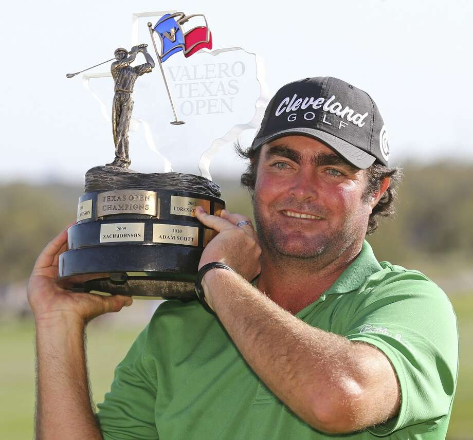 Steven Bowditch poses for photos with the trophy after winning the 2014 Valero Texas Open Sunday March 30, 2014 at TPC San Antonio. Photo: San Antonio Express-News