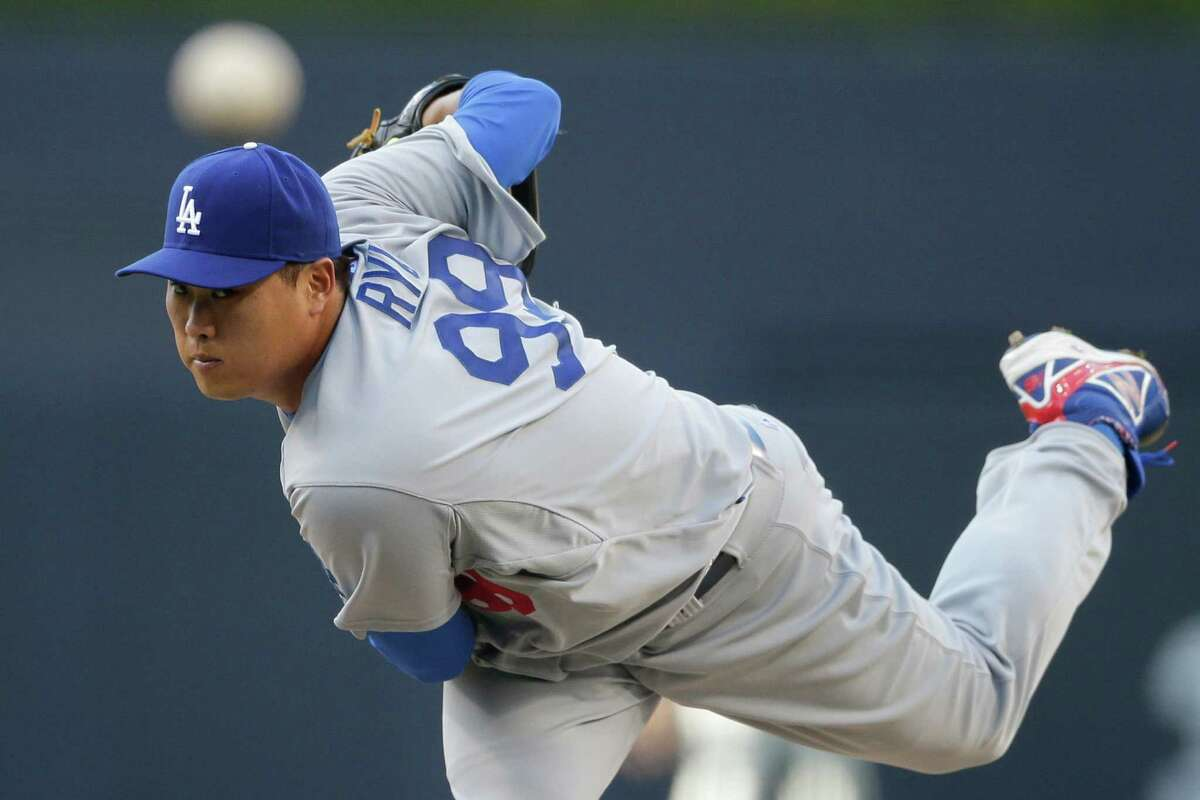 Los Angeles Dodgers starting pitcher Hyun-Jin Ryu pitches to a San Diego Padres batter during the first inning of an opening night baseball game Sunday, March 30, 2014, in San Diego. (AP Photo/Gregory Bull) ORG XMIT: CAGB112