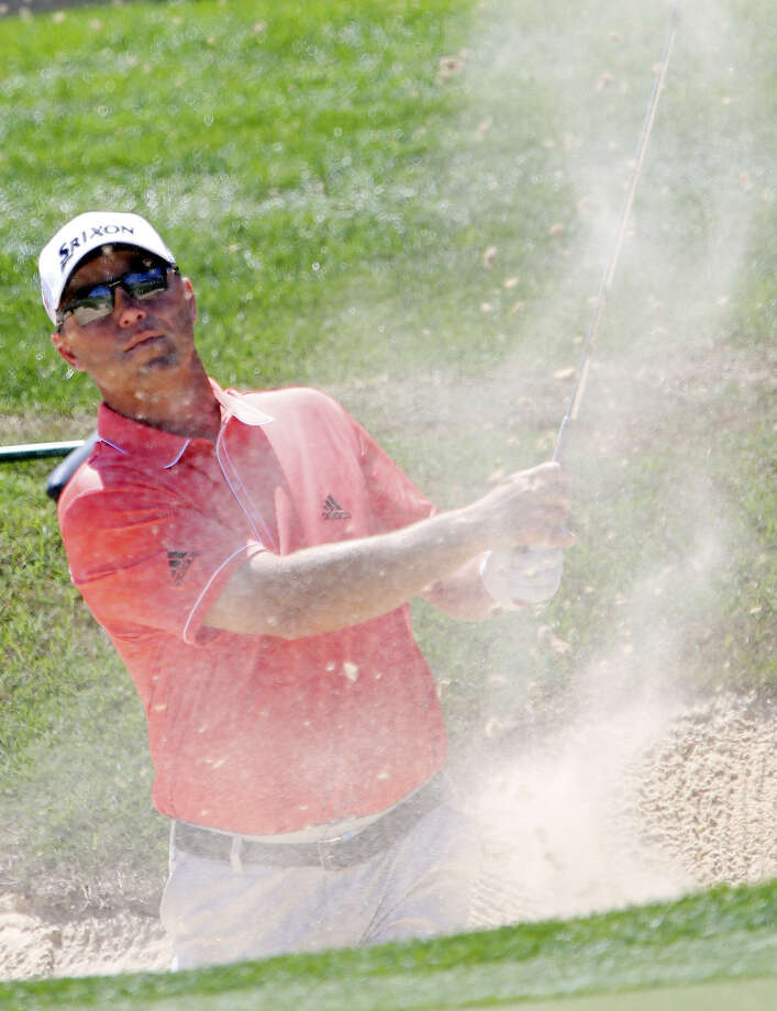 San Antonio's Cameron Beckman, who fired a 2-over 74 in the final round of the Valero Texas Open to finish tied for 36th, hits out of a bunker on No. 16. His finish was worth $28,572. Photo: Edward A. Ornelas / San Antonio Express-News / ©2014 San Antonio Express-News