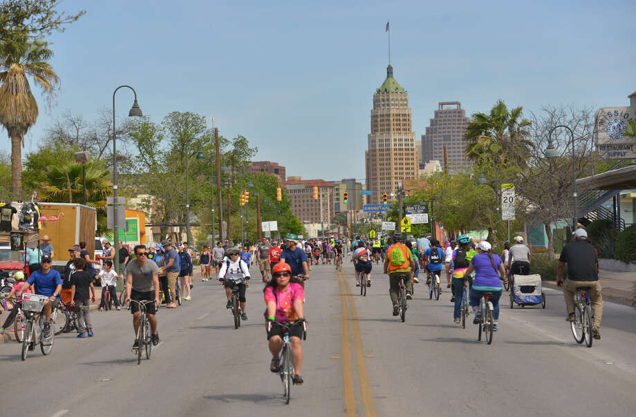 Cyclists crowd South St. Mary's Street to participate in Siclovía on a day free of cars, trucks and exhaust. Photo: Photos By Robin Jerstad / For The San Antonio Express-News