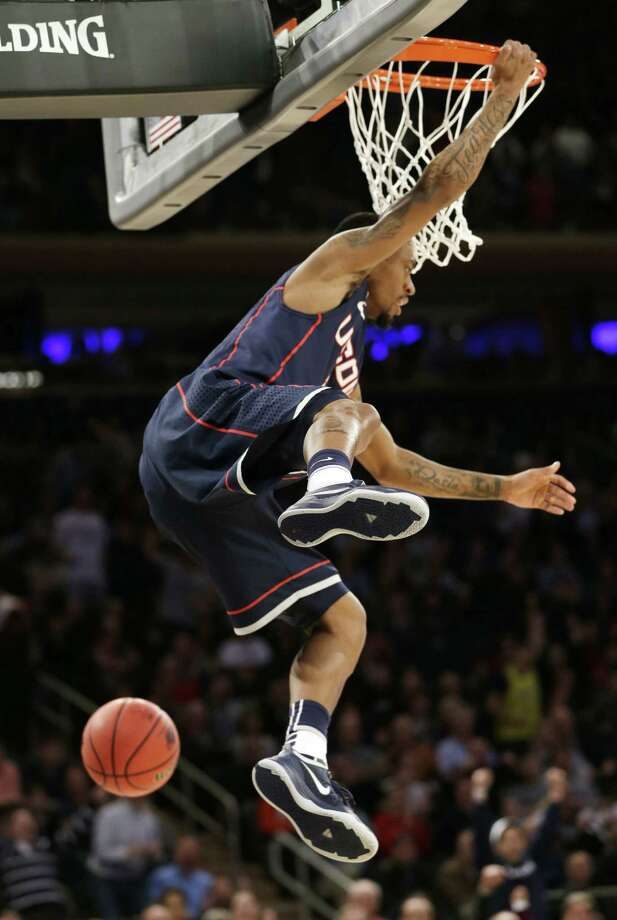 Ryan Boatright's dunk helped improve Huskies coach Kevin Ollie's NCAA tournament record to 4-0. Photo: Seth Wenig / Associated Press / AP