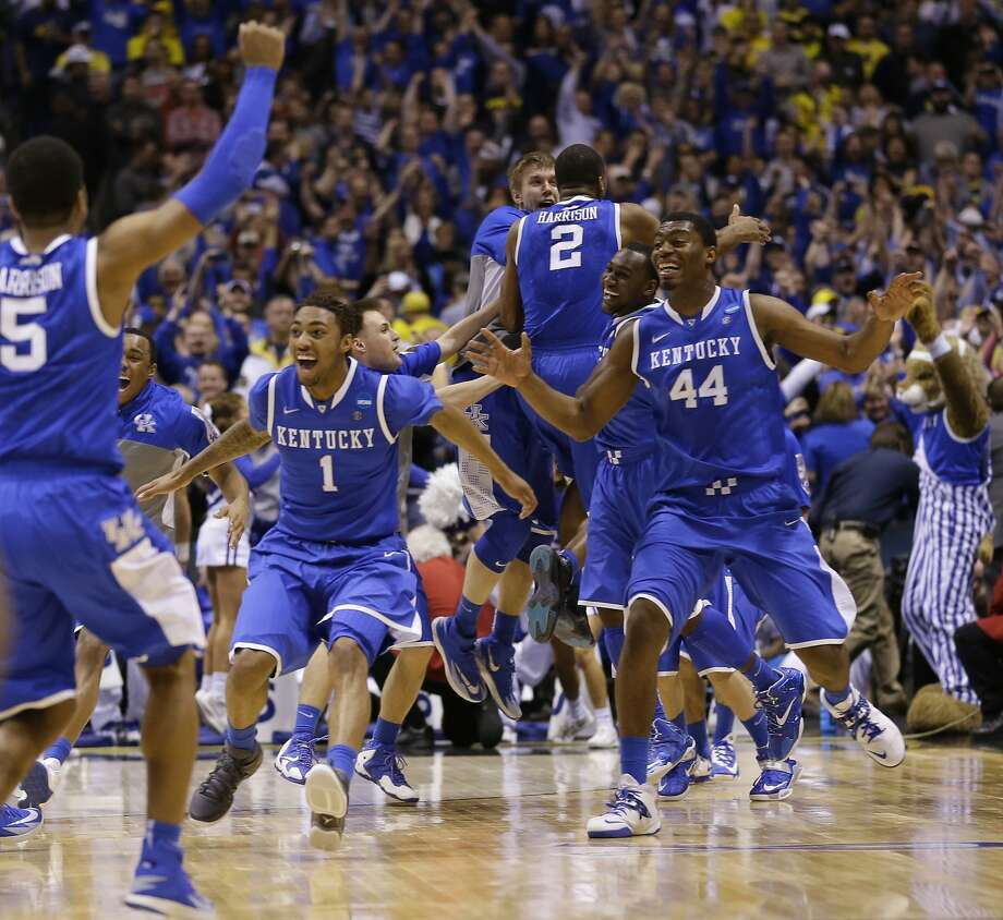 Kentucky  players celebrate after an NCAA Midwest Regional final college basketball tournament game against Michigan Sunday, March 30, 2014, in Indianapolis. Kentucky won 75-72 to advance to the Final Four.(AP Photo/Michael Conroy) Photo: Michael Conroy, Associated Press