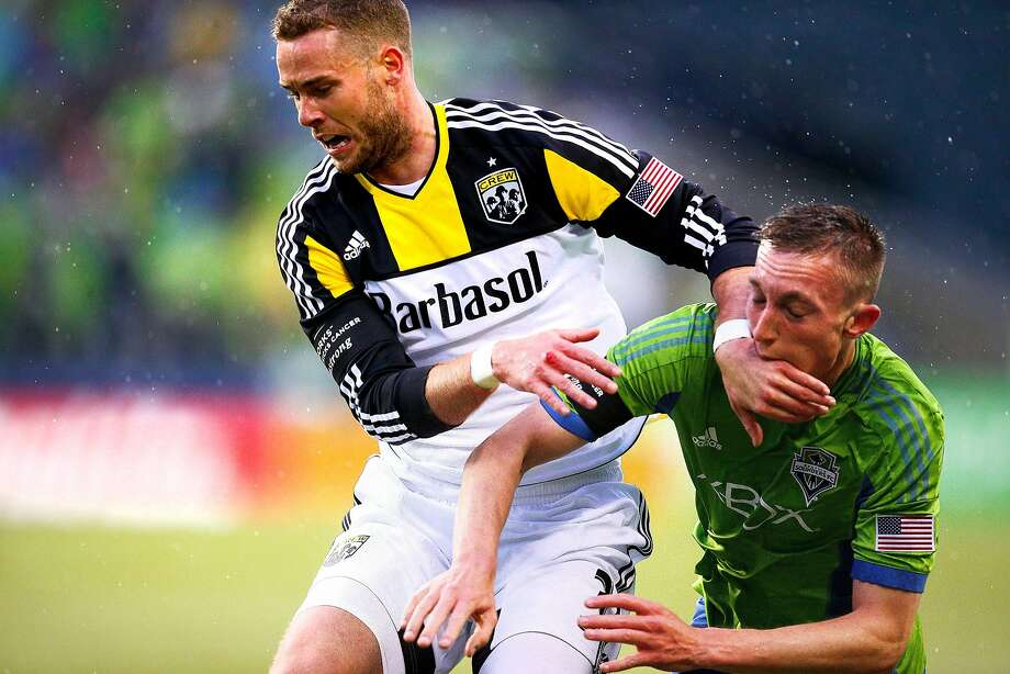 SoundersFC's Dylan Remick, right, gets blocked by Columbus Crew's Josh Williams in the first half at CenturyLink Field on Saturday, March 29, 2014, in Seattle, Wash. Columbus won 2-1. (AP Photo/The Seattle Times, John Lok) Photo: John Lok, Associated Press