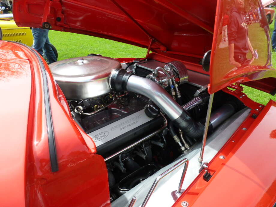Looking under the hood of Dennis O'Connell's 1955 Ford pickup.