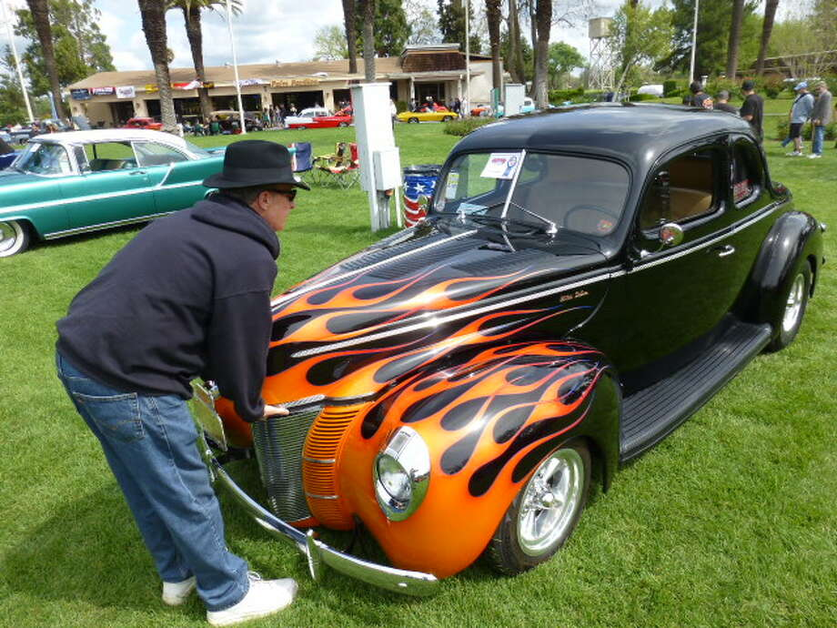 Rod Schweiger, closing the hood of his 1940 Ford Deluxe.