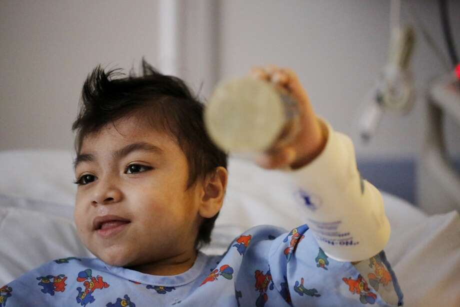 Julian Barajas, 9, shakes a rhythm instrument during a therapy session with Oliver Jacobson, music therapist at UCSF Benioff Children's Hospital, on Wednesday March 26, 2014 in San Francisco, Calif. Photo: Mike Kepka, The Chronicle
