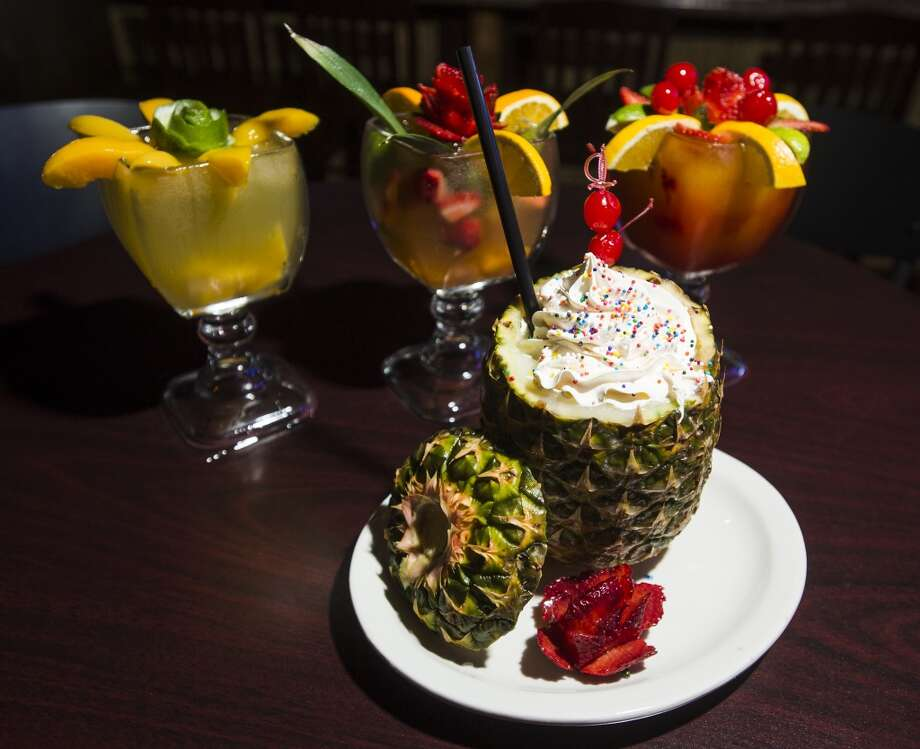Pictured is the Peach Rita, the Fruity Rita, and a Passion Fruit Rita, background left to right, and a pineapple pina colada, all prepared at the Jungle Sports Bar and Grill on Wednesday. The newly opened Jungle Sports Bar and Grill in Nederland is the CAT5 Bar of the Week for March 27, 2014. Photo taken Wednesday, 3/19/14 Jake Daniels/@JakeD_in_SETX