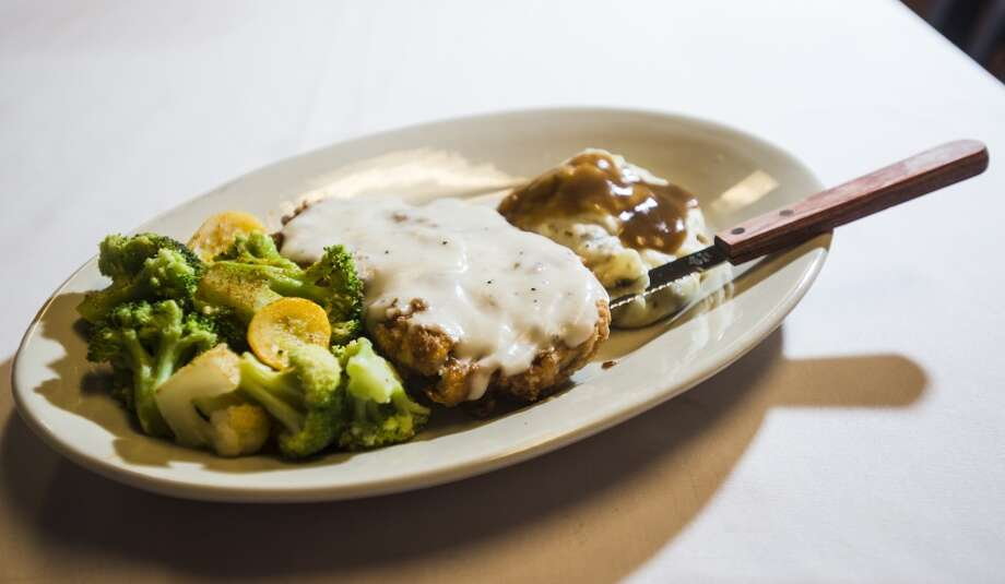 Pictured is the Chicken-Fried Steak plate, served with mixed vegetables and mashed potatoes, from Jungle Sports Bar and Grill. The newly opened Jungle Sports Bar and Grill in Nederland is the CAT5 Bar of the Week for March 27, 2014. Photo taken Wednesday, 3/19/14 Jake Daniels/@JakeD_in_SETX