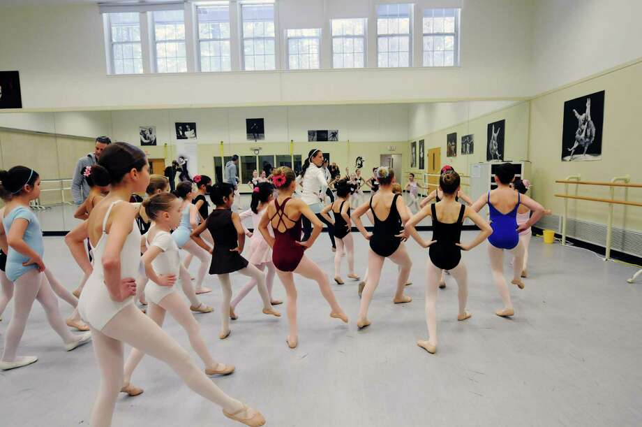 Girls run through steps as a group during tryouts for a New York City Ballet performance this summer on Sunday, March 30, 2014, at the National Museum of Dance in Saratoga Springs, N.Y.  One hundred girls tried out for the 48 spots.  The girls chosen will perform with the New York City Ballet this summer at SPAC in the Circus Polka.  (Paul Buckowski / Times Union) Photo: Paul Buckowski / 00026104A