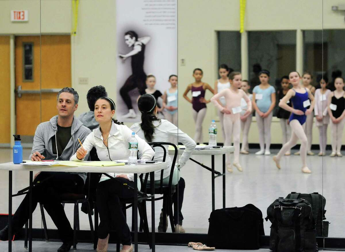 New York City Ballet children's ballet masters, Arch Higgins, and Dena Abergel watch girls perform during tryouts for a New York City Ballet performance this summer on Sunday, March 30, 2014, at the National Museum of Dance in Saratoga Springs, N.Y. One hundred girls tried out for the 48 spots. The girls chosen will perform with the New York City Ballet this summer at SPAC in the Circus Polka. (Paul Buckowski / Times Union)