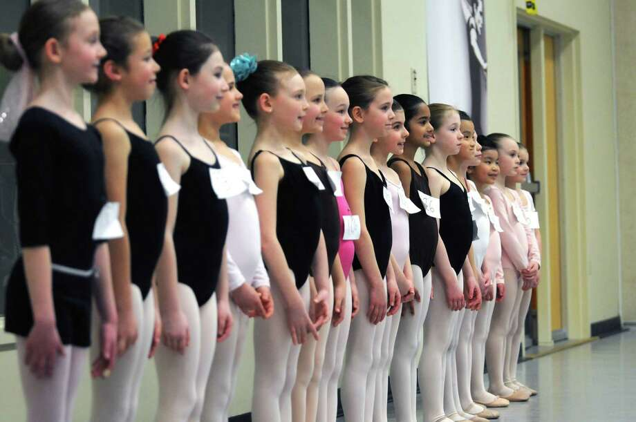 Young dancers line up during tryouts for a New York City Ballet performance this summer on Sunday, March 30, 2014, at the National Museum of Dance in Saratoga Springs, N.Y.  One hundred girls tried out for the 48 spots.  The girls chosen will perform with the New York City Ballet this summer at SPAC in the Circus Polka.  (Paul Buckowski / Times Union) Photo: Paul Buckowski / 00026104A