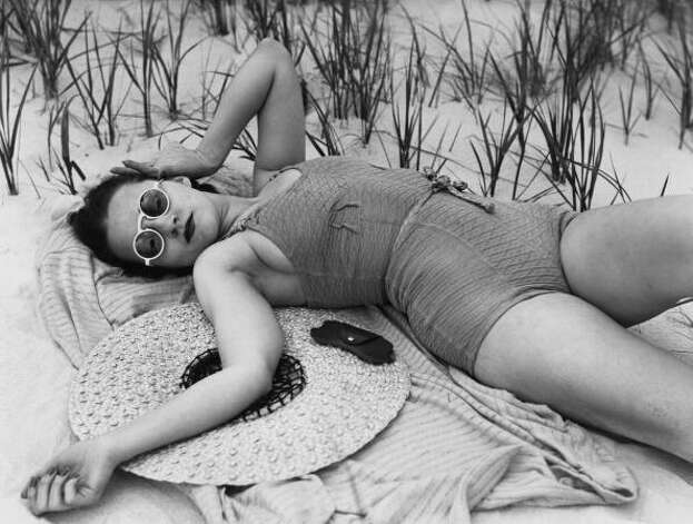 1937 model marcella flood relaxes in a one piece swimsuit photo
