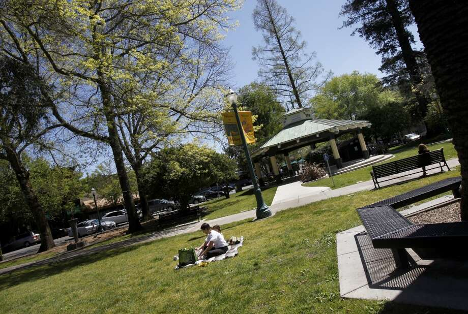 Large grass areas of the plaza in downtown Healdsburg are the perfect place to stretch out after a big meal. The downtown plaza area of Healdsburg, Calif. has become a real attraction for wine and food in Sonoma County. Photo: Brant Ward, The Chronicle