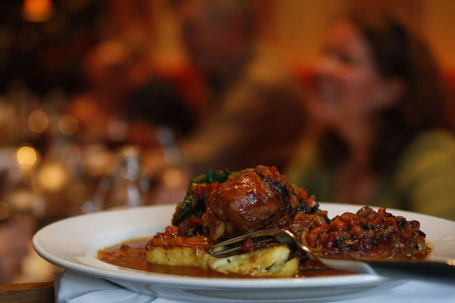 If you go, you have to try the Nonna's Tomato-Braised Chicken, which is served atop polenta. Serious comfort food. Photo: Eric Luse, The Chronicle