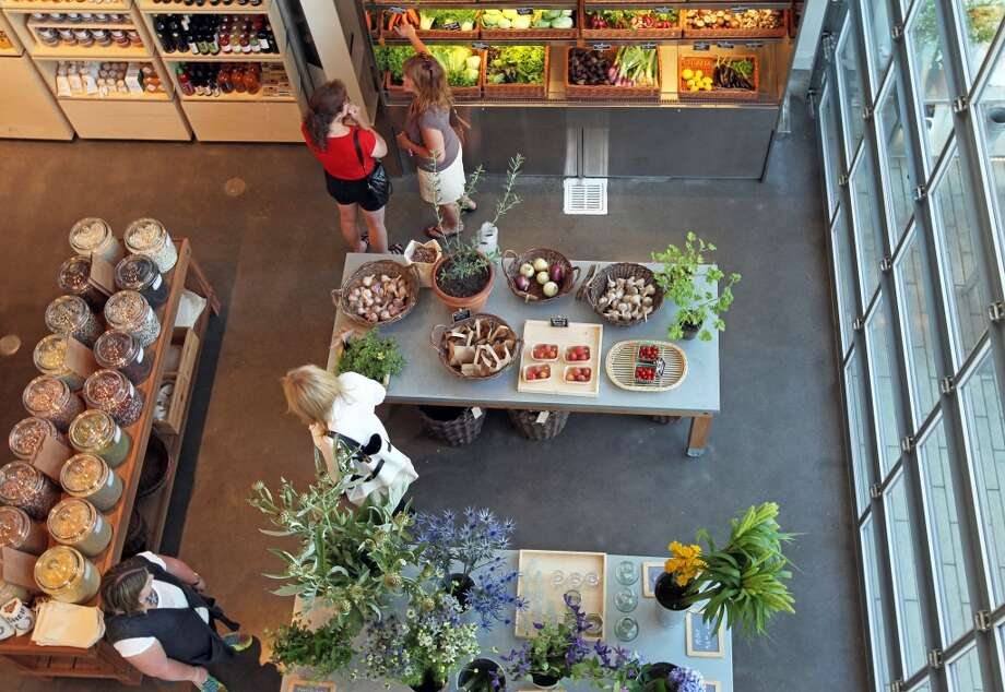 Shoppers visit the produce section of SHED. The space includes a cafe, market, and cookware. Photo: Lance Iversen, The Chronicle