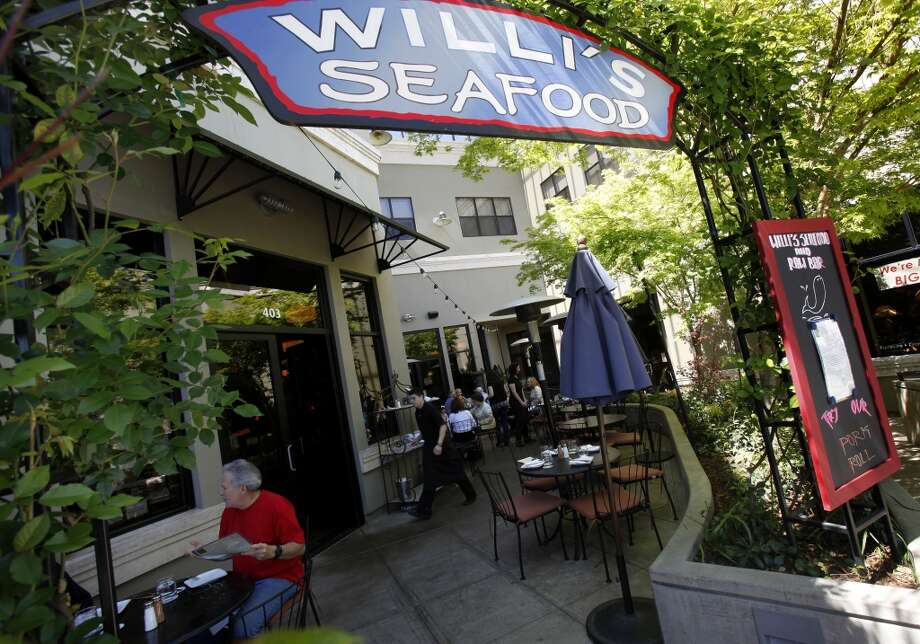 Willi's Seafood & Raw Bar (not to be confused with Willi's Wine Bar in Santa Rosa) has an attractive patio area and small plates great for sharing. Photo: Brant Ward, The Chronicle