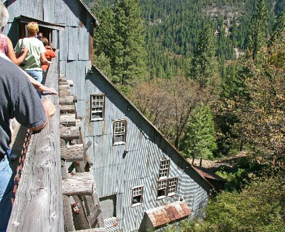 SIERRA CITY: Visitors cross the Kentucky Mine walkway to the stamp mill in Sierra City. Early miners, pushing heavy ore carts across this walkway, had no handrails. (Drive time: 3.5 hours)  Read more: Mining town a hiker haven Photo: Mark S. Bacon, Special To The Chronicle