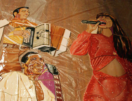A section of a mural dedicated to Texas music Friday July 14, 2005 at the Ella Austin Community Center. Some of the musicians featured are Flaco Jimenez, T Bone Walker, Selena, Ornette Coleman, Buddy Holly, Willie Nelson, Beyonce, Scott Joplin. / SAN ANTONIO EXPRESS-NEWS