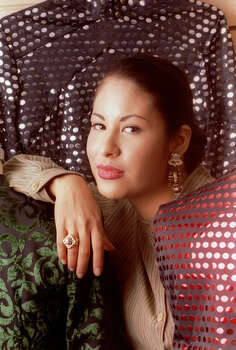 Tejano music star Selena poses in this March 7, 1995, file photo  in Corpus Christi, Texas. Selena was shot to death in Corpus Christi on March 31, 1995 by the president of her fan club. Some say that when Selena died, Tejano, the genre of Texas border music she popularized, lost its leader and way. Fifteen years later, aficionados say Tejano's influence could be revived in a younger generation. / HOUSTON CHRONICLE
