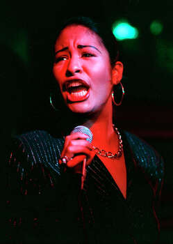 SELENA / ADVANCE FOR FEATURES / ELAINE AYALA. -- Tejano music star Selena performs at the grand opening of the San Antonio Hard Rock Cafe in this Jan. 25, 1995. / SAN ANTONIO EXPRESS-NEWS