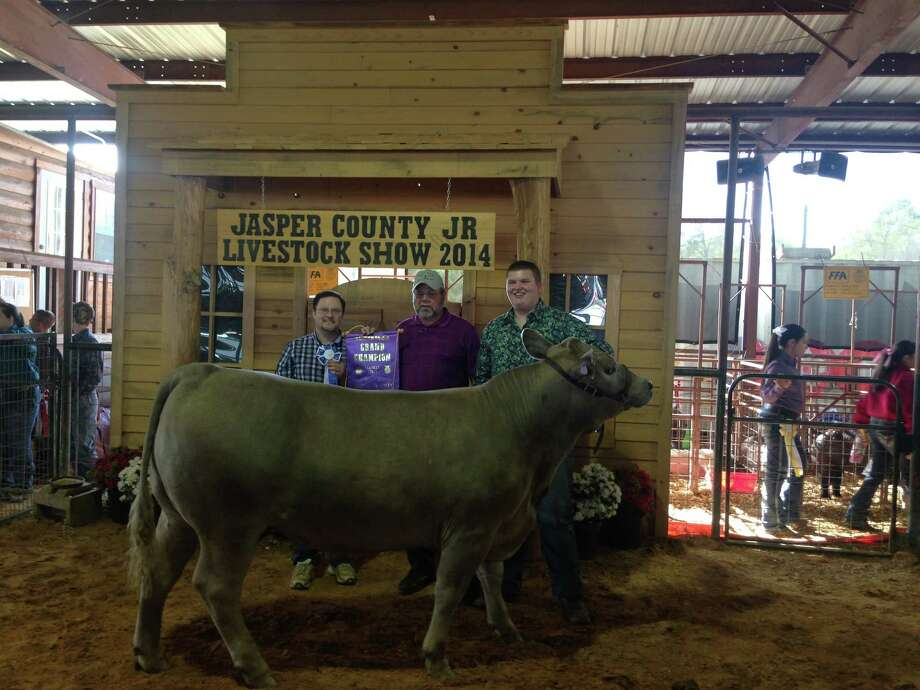 Ethan Cole with Charles frazier who bought the Grand Champion Steer. Photo by Shannon Stott