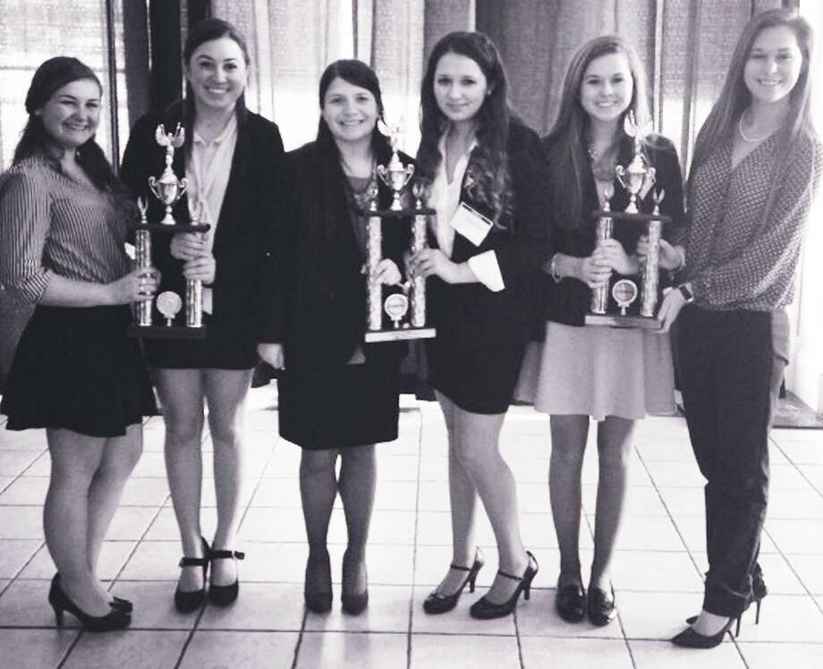 Headed to nationals in Atlanta, Ga. in early May, 2014 based on their performance at a recent DECA compeitition are New Milford High School students, from left to right, Abbey Zimmerman, Devon Woods, Christina Kwapien, Taylor Terranova, Carolyn O'Hara and Rachel O'Hara. April 2014 Photo: Contributed Photo / The News-Times Contributed