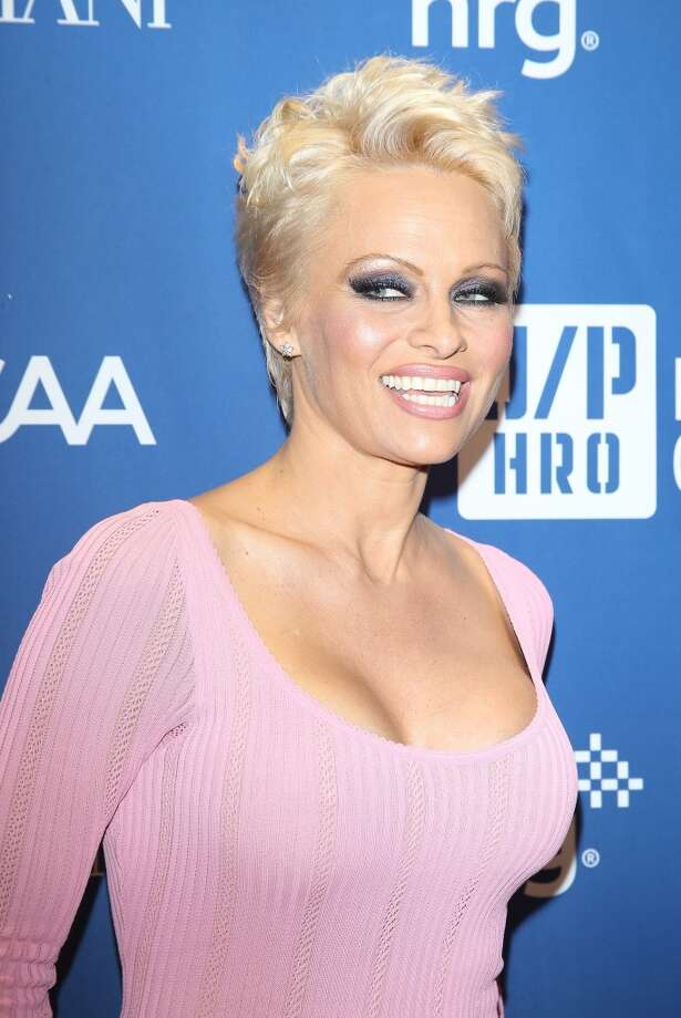"Pamela Anderson's pixie cut is definitely a departure from her long, flowing locks. She told Elle Magazine, ""At first I thought I looked like Anderson Cooper or like a Q-tip or something.  But now I feel really powerful."" Photo: Michael Tran, FilmMagic"
